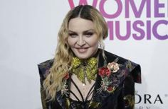Madonna moves to Portugal~The USA is now a better place!