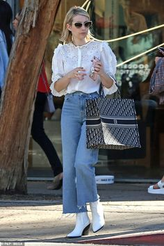8fc19a68aa0 Emma Roberts teams pretty white blouse with mom jeans in LA