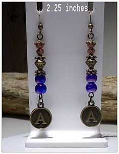 Antique bronze earrings:french hooks,glass blue/purple beads, bead caps, and letter A.charm.tiny beige glass beads.2.25 inches. I will take custom orders with your fav letters and the size you need and the color.Pm me please.