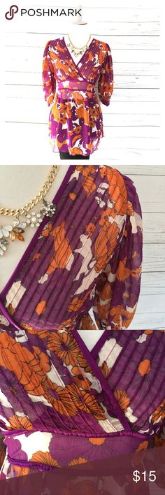H&M Orange & Purple Chiffon Floral Tie Back Tunic H&M Orange & Purple Chiffon Floral Tie Back Tunic 100% polyester Floral print Sheer material Ties in the back Peasant sleeves Tunic Beautiful summer and fall blouse   Thank you for your interest in my item. Be sure to check out the rest of my closet. H&M Tops Tunics