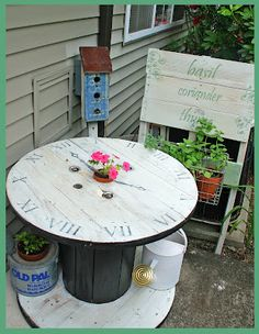 LilyPinkScraps: Upcycled garden table. These spools are available from the telephone company.Well, that is where I got mine from years ago. I was just never clever enough to stencil on the numbers