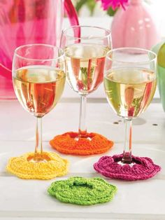 Flower Goblet Footies Crochet Pattern Download from e-PatternsCentral.com -- Vividly hued flowers designed to fit over the base of stem glassware will help protect your tabletop, and different colors will identify each guest's glass.