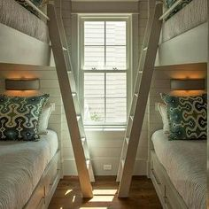 Geoff Chick - bedrooms - light gray bunk room, light gray wood panels, light gray plank walls, light gray wall panels, light gray plank boards, built-in bunk beds, light gray bunk beds, bunk bed storage, bunk beds drawers, bunk bed ladders, crown moldings, girls crown moldings, bunk room crown moldings, reading lights, bunk bed sconces, bunk bed reading lights, green and blue pillows, pillows with fringe trim, bunk bed ladders, removable bunk bed ladders, white bunk bed ladders, bunk beds…