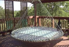 So, I'm seeing here an old trampoline base, some padding to cover the metal, either a custom canvas base or webbing created by rope weaving, and cushions... who is going to take the plunge and try this out? Maybe find an old trampoline at the local tip or recycling house? on The Owner-Builder Network  http://theownerbuildernetwork.co/wp-content/blogs.dir/1/files/swings/Swings-6.jpg