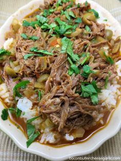 Ropa Vieja (means old clothes) is a Cuban beef stew.  It's made in the crockpot and it's fabulous!
