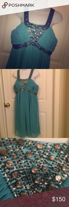 Item Turquoise Sparkly Dress Worn Once | Excellent Condition | Pretty Turquoise Color | Silver/Grey Bead Work | Tank Top Style Straps | Flowy Style | Zipper in the Back | Hits My Calves | I'm 5'2'' |  Trades | Feel Free to Ask Questions | More  Upon Request | Bundles & Offers are Welcomed ❤️| Decode 1.8 Dresses Prom