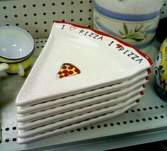 A set of six ceramic pizza-slice plates.A set of six ceramic pizza-slice plates.