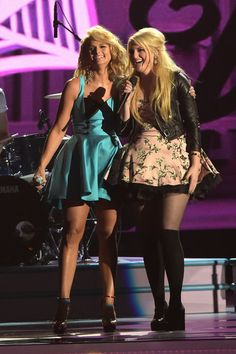 Miranda Lambert Photos Photos - Miranda Lambert and Meghan Trainor perform during the 48th annual CMA awards at the Bridgestone Arena on November 5, 2014 in Nashville, Tennessee. - 48th Annual CMA Awards - Show