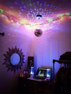 stoner room. love how the disco ball + christmas lights make sacred geometry art all over the walls