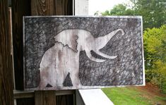 Anyone else love elephants?! This piece is stained, and white washed and the string is hand-dyed to the perfect steel gray.  This elephant is a
