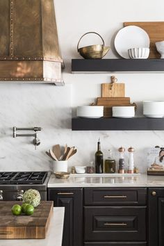 Copper Kitchen accents done beautifully in this navy and marble kitchen Brianna Michelle Interior Design