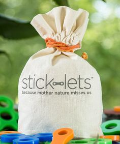 Stick-lets Teepee Set: Connect your little one to nature with this unique silicone Stick-let set that can be used to craft forts, tents and toys from twigs or sticks while supporting the designs with durable, flexible joints.