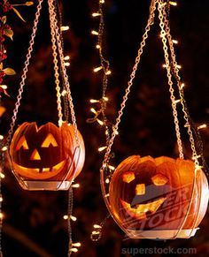 Use a plant hanger for your pumpkins or Dollar Store Jute hangers and a pie tin--insert pumpkin--add lights