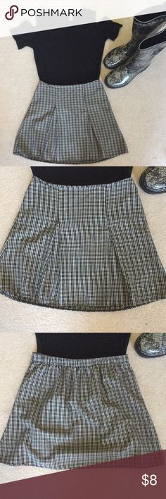 Brandy Melville Black and Tan Plaid Kaitlee Skirt This is such a cute skirt! I believe it is called the Kaitlee skirt. It's marked as one size, and there is some elastic in the back of the waistband, but I'd say it best fits XS to S. The only flaw is that the thread on one of the pleats is starting to come loose as pictured. It would be an easy fix for someone good with a needle and thread, but that is not me It's priced accordingly. Shirt and boots also available in my closet. Comment with…