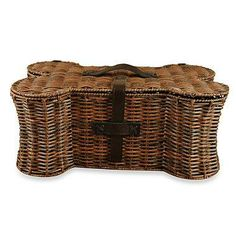 Keep your home neat and free of pet toy clutter with this handsome, bone-shaped pet toy storage basket. Designed to keep pet toys out of sight when not in use, this durable basket can hold up to 5 pounds of items.