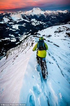 There is snow stopping this daredevil biker after he hurtled down the powder-covered Alps. Professional cyclist and surfer Tito Tomasi, 29, from Nice, France, pushed his Rocky Mountain Blizzard Fat Bike to the limit on the slopes of the Aravis mountains on Saturday (December 13). Photographer Alex Buisse, 29, from Chamonix, France, braved the ...: