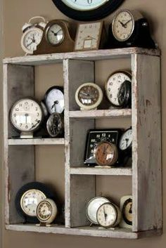 Various Alarm Clock Collection using an old wooden crate as a shelf