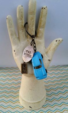 Check out this item in my Etsy shop https://www.etsy.com/listing/210079569/blue-porche-vintage-tootsie-toy-keychain