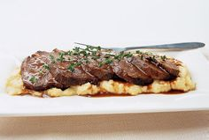 Beef Braised in Barolo  Try slowly braising boneless beef chuck and pancetta in a heady mix of Barolo wine, garlic, tomatoes, thyme, and rosemary.