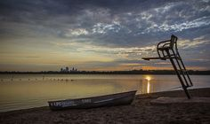 Sunrise on Thomas Beach looking at the Minneapolis skyline across Lake Calhoun