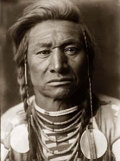 Here for your enjoyment is an inspiring photograph of Chief Child. It was made in 1908 by Edward S. Curtis.    The photo illustrates a Head-and-shoulders portrait of a Crow Indian Chief. The man is shown in traditional Crow dress and hair style    We have compiled this collection of photos mainly to serve as a vital educational resource. Contact curator@old-picture.com.    Image ID# B9D26455