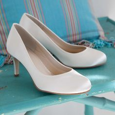 Shelly - A perfectly unspoilt take on the all American pumps with a lovely round toe, a sexy low cut and a sleek little kitten heel. This great wide fit wedding shoe is both comfortable with its bliss lining and wonderfully flattering with its stunning cut. £69.00