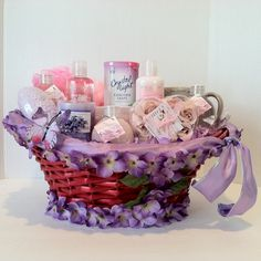 Give her the royal treatment with this luxurious spa gift basket featuring Cherry Blossom  (2) Shower Gel 1 Body Lotion 1 Body Scrub 1 Mini Sponge 1 Body Sponge 1 Cup 1 Candle 1 Soap Rose Petals 1 Cleansing Bar Bubble Bath Bath Salt Crystal Light Grape