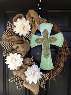 Burlap on wreath. Another fabric. Use wood letter M. Possibly flowers.