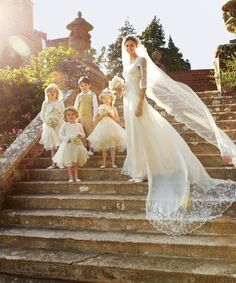 Breath taking... love her vintage inspired dress and veil carried on with the flower girls and ring barrier LOVE!!