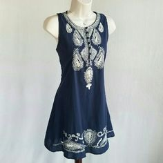 Cute Options blue shift dress Navy blue shift dress with white embroidery on yoke and hem and button detail on yoke.  In great condition.  Bust 19 / waist 18 / length 33 inches.  100% cotton.   Thanks for visiting my closet; come back soon & see what's new! I add listings every week! Cute Options Dresses