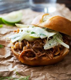 Soft pretzel buns filled with tender, juicy apple bourbon pulled pork and topped with a refreshing apple fennel slaw. The King of pulled pork sandwiches!