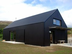 New Black corrugated house and outbuilding on Skye complete and occupied. The interior is lined entirely in douglas fir. New Black corrugated house and outbuilding on Skye complete and occupied. The interior is lined entirely in douglas fir. Modern Barn House, Barn House Plans, Metal Building Homes, Building A House, Building Plans, Farm Shed, Black House Exterior, House Cladding, Black Barn