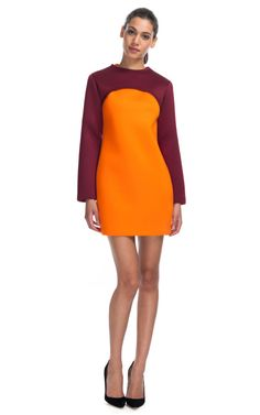 This neoprene-finished cotton pullover features long sleeves and a cropped, curved hem Pull over style 100% cotton