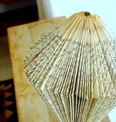 """This post is a follow-up on the post I made October 2011 """"paper protea"""" where I showed how to fold a protea looking flower with a book. Th... Folded Book Art, Book Folding, Book Sculpture, Paper Sculptures, Paper Cutting, Cut Paper, Paper Art, Book Crafts, Paper Crafts"""