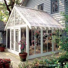 ...screened porch with plastic panels for roof offers the look of a conservatory.