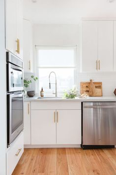 The red oak floors contrast beautifully with the white laminate cabinets.