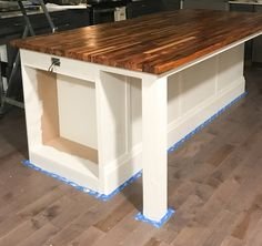 How we created our DIY Kitchen Island with prefab cabinets, a little trim, and unfinished butcher block countertops for an upscale custom look. Kitchen Island Decor, Modern Kitchen Island, Home Decor Kitchen, Country Kitchen, Kitchen Furniture, New Kitchen, Kitchen Ideas, Rustic Kitchen, Kitchen Designs