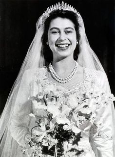 When the future Queen Elizabeth II (pictured) walked down the aisle in London's Westminster Abbey in 1947, her wedding dress was more than a fashion statement: It represented the hopes of a nation, according to royal wedding gown curator Joanna Marschner.
