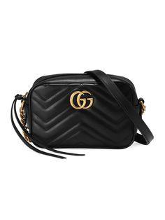 Shop the GG Marmont matelassé mini bag by Gucci. The mini GG Marmont chain shoulder bag has a softly Gucci Purses, Gucci Handbags, Leather Handbags, Designer Handbags, Mini Handbags, Gucci Gucci, Designer Purses, Cheap Handbags, Handbags Online