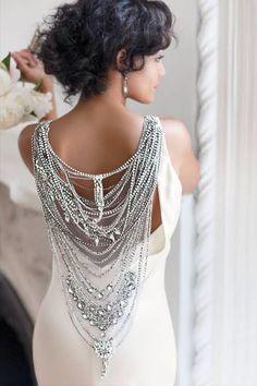 Selita Ebanks - Silk column with Swarovski crystals and beads, $6,880, Johanna Johnson; Earrings, Julieri Jewelry