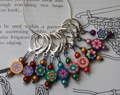 Your place to buy and sell all things handmade Crochet stitch markers. I need some, especially cuz I have little ones & I set my project down to do something & it's the first thing they grab if it's in reach Crochet Tools, Knit Or Crochet, Loom Knitting, Knitting Stitches, Techniques Couture, Knitting Accessories, Stitch Markers, Crochet Flowers, Beaded Jewelry