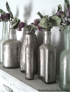Technique | SILVERING :: The technique used on these bottles involved liquid silver leaf, rust (that can be scraped off a rusty object...or you can make a rusty object by spritzing a metal object w/ salty water, letting it dry & repeating), dirt & water. So cool! | #villabarnes