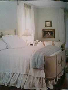 I love this style of bed with the curves--I envision this in a glamorous bedroom in the 1940s...