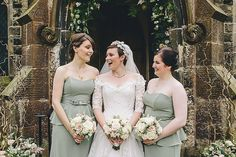 Bridesmaids wear strapless sage gowns  | Photography by http://thetwinsweddings.co.uk/