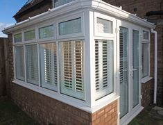 White shutters fitted by Shuttercraft Northants White Shutters, Conservatory, Window Coverings, Garage Doors, Home Appliances, Windows, Wood, Outdoor Decor, Home Decor
