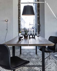 Our dining table TRACK is made of masive oak planks and black powder coated…