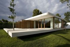 Single concrete plane folds to form floor and ceiling.