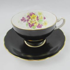Staffordshire Black Tea Cup and Saucer with Purple and Yellow Flowers, Vintage Tea Cup, Bone China Antique Tea Cups, Vintage Cups, Vintage Tea, Types Of Tea, Bone China Tea Cups, Tea Service, Yellow Flowers, Fine China, Cup And Saucer