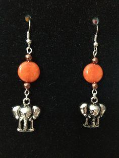 Brown and Orange Elephant Earrings by queenofqeeks on Etsy, $8.00