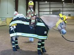 CKRH Ingrid the Firefighter. Horse costume by Shirley Gentry